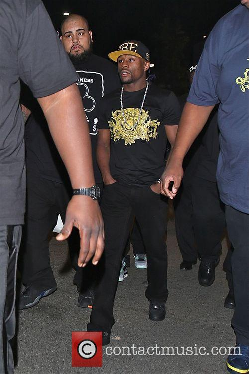 Floyd Mayweather Jr. walking with security after the...