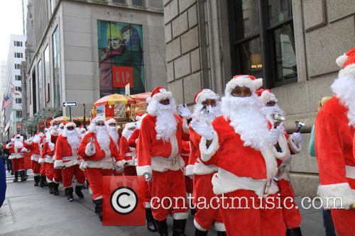 A tradition since 1902 of Sidewalk Santa has...