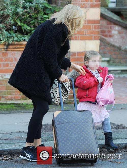 Abbey Clancy and her daughter out and about