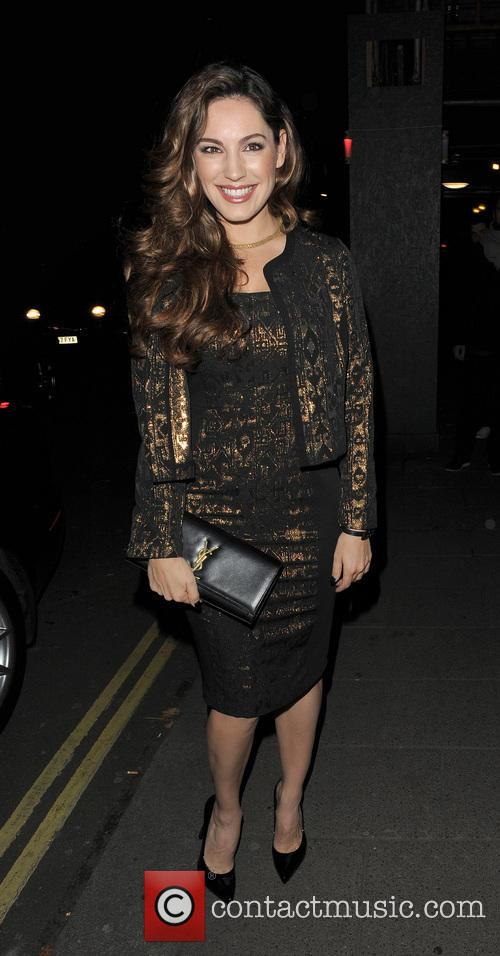 Kelly Brook leaving her home, and heading to...