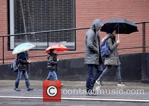 Liev Schreiber and family on a rainy outing