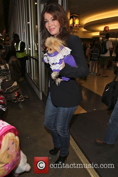 Lisa Vanderpump and her dog Giggy arrive at...