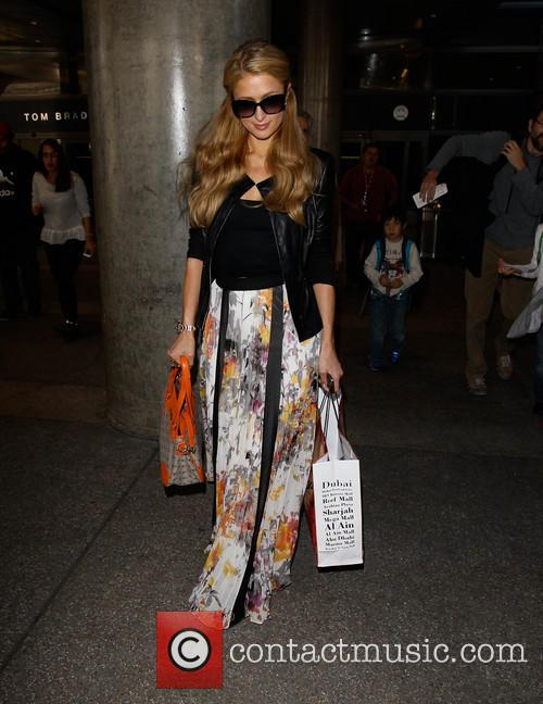 Paris Hilton Arrives At LAX