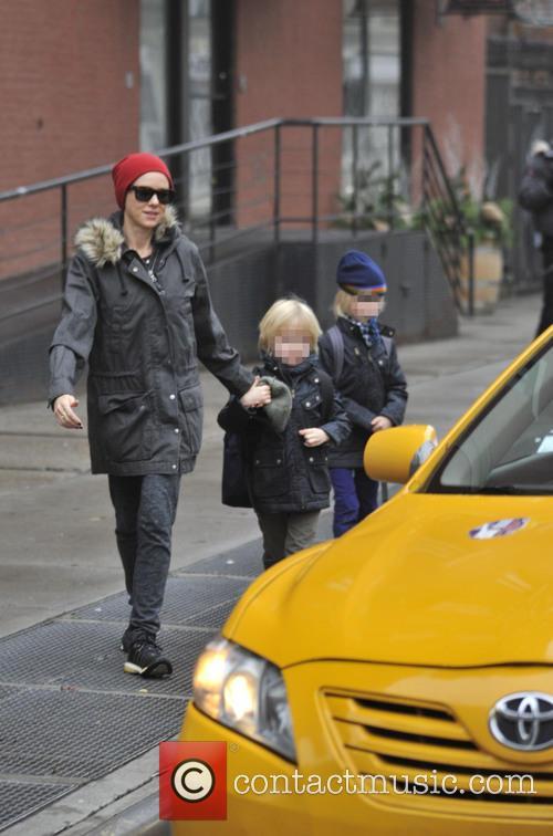 Naomi Watts hails a cab