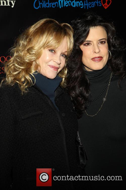 Melanie Griffith and Guest 1