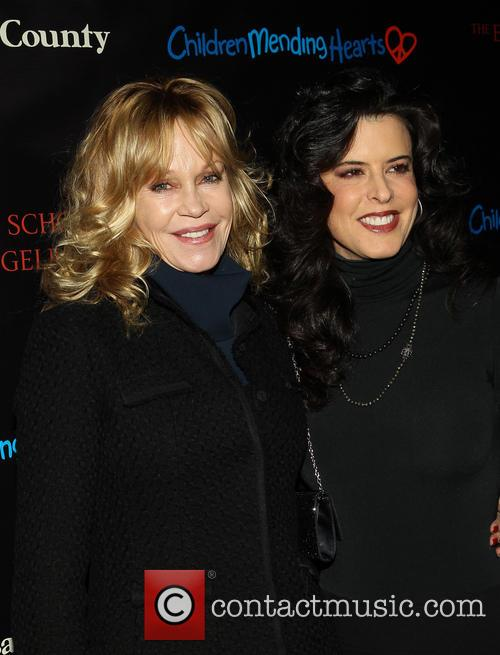 Melanie Griffith and Guest 6