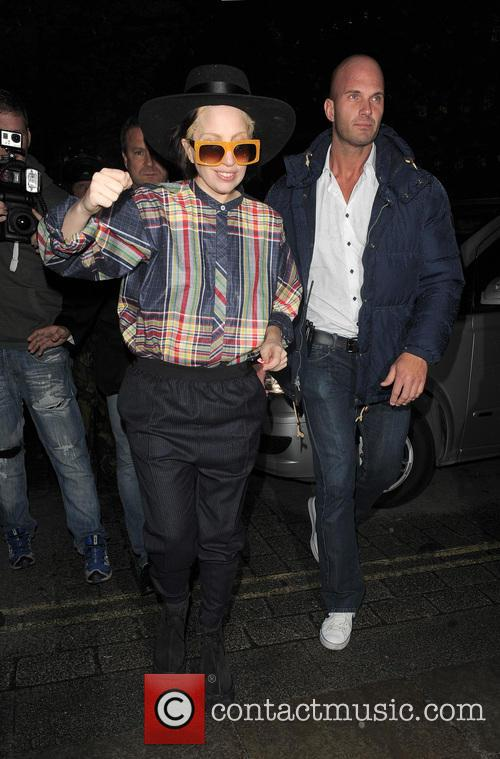Lady Gaga returns to her hotel, wearing a...