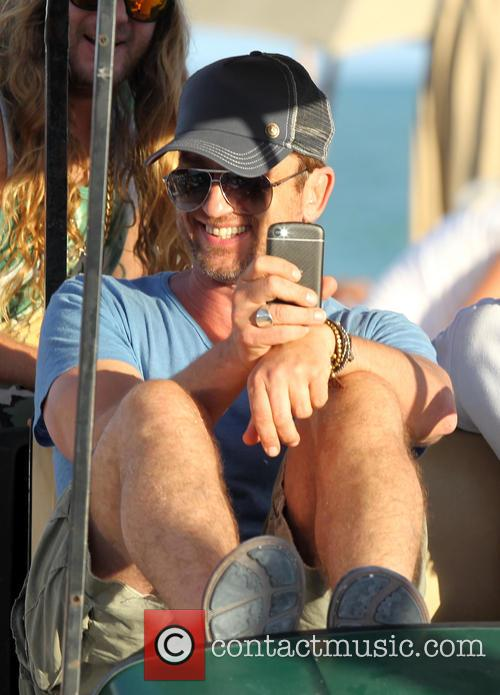 Gerard Butler spends an afternoon with friends in Miami Beach