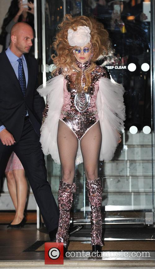 Lady Gaga leaves her London hotel to perform...