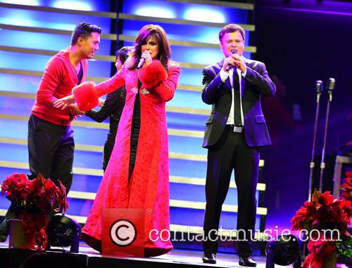Marie and Donny Osmond performing live