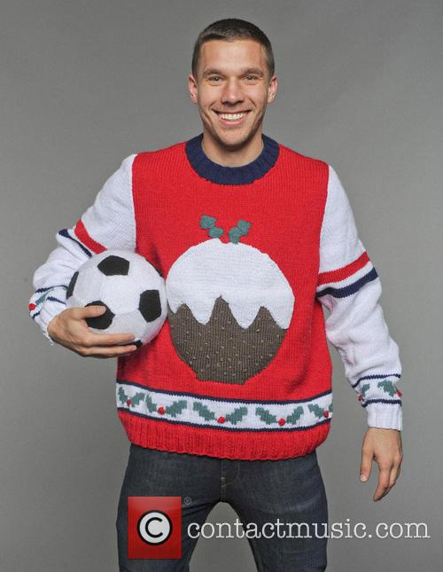 Arsenal players wear Christmas jumpers for Save the...