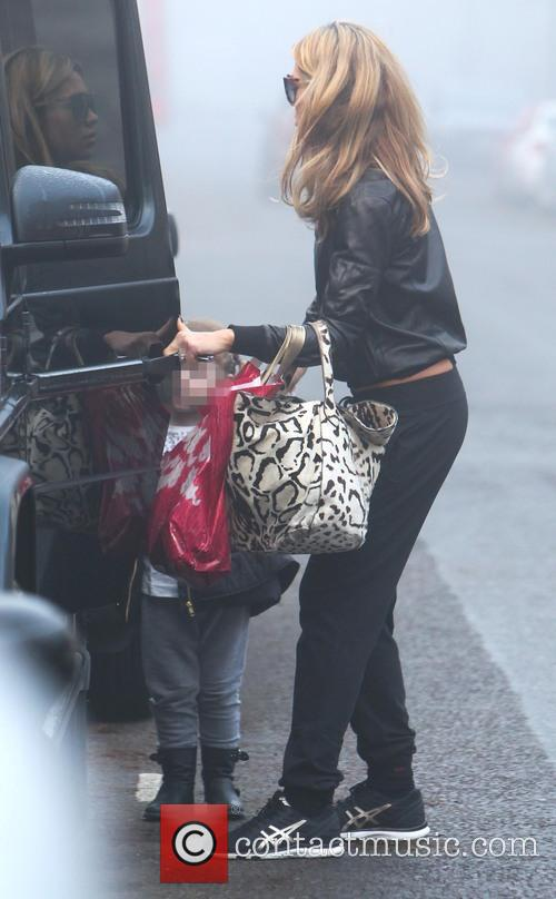 Abbey Clancy leaves home with her daughter