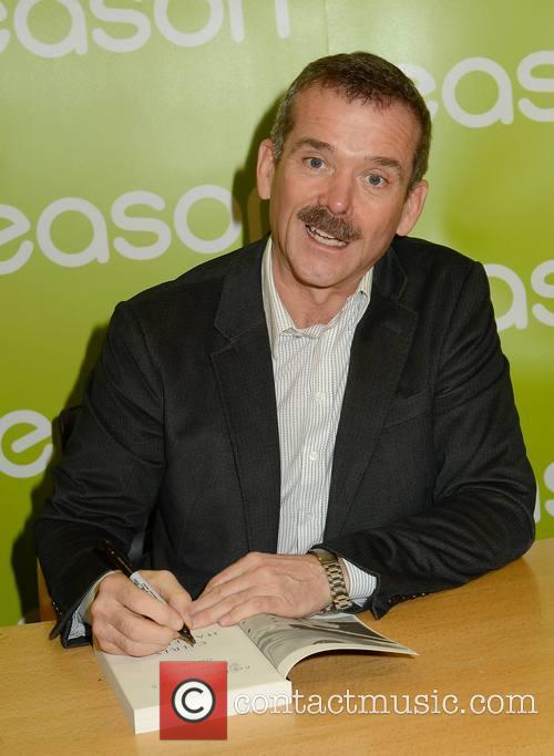 Astronaut Chris Hadfield signs copies of his book...