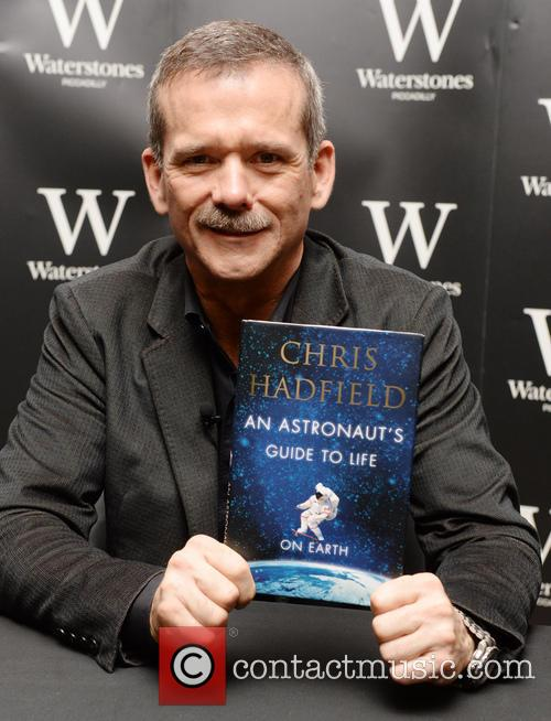Chris Hadfield signs copies of his book entitled...