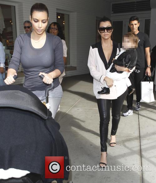 Kim and Kourtney Kardashian 1