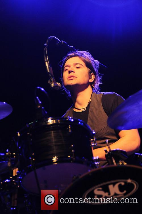Hanson perform on stage at the Magazzini Generali
