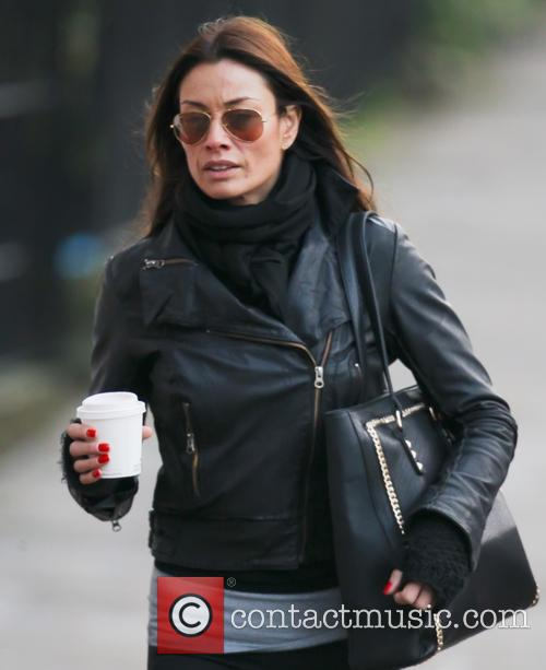 Melanie Sykes wraps up warm for the winter weather while walking near her London home