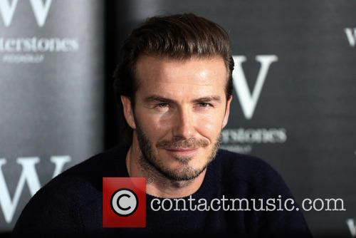 David Beckham signs copies of his new book