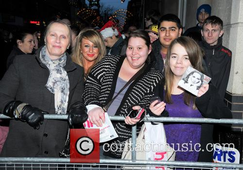 Sam Bailey signing copies of her single 'Skyscraper'...