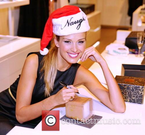 Petra Nemcova signs her charity candles