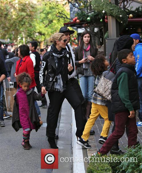 Heidi Klum shops at The Grove with her...