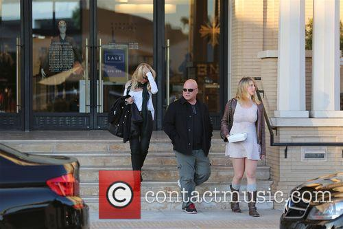 Michael Chiklis and family leave Barney's new York