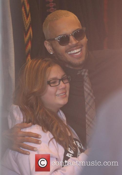 Chris Brown and Guest 1