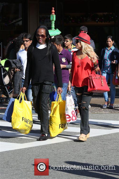 Verdine White shops with his gal pal at...