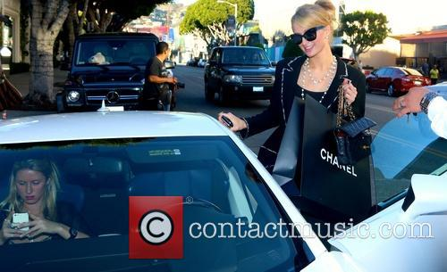 Paris and Nicky Hilton and their mother Kathy do some last minute Christmas Eve shopping