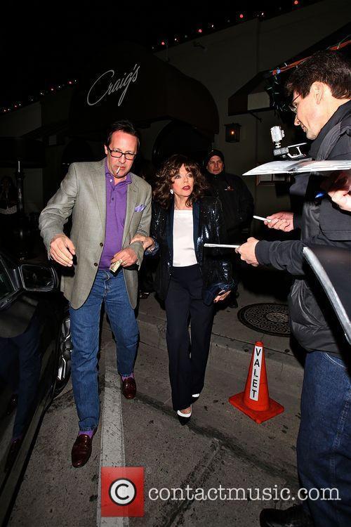 Joan Collins leaves Craig's
