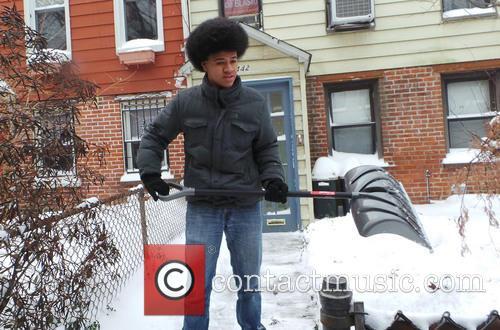 Dante de Blasio shovels snow outside his home