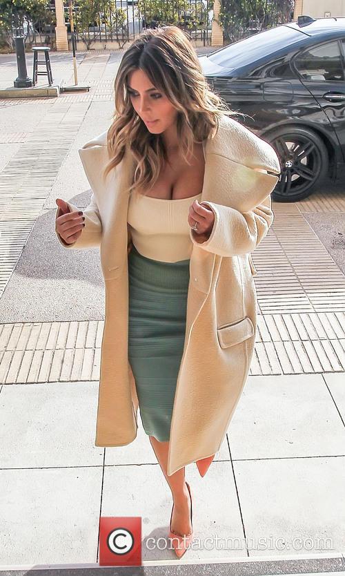 Kim Kardashian shows off her cleavage