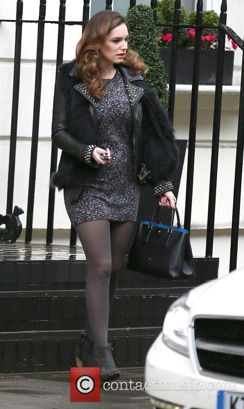 Kelly Brook leaves her house