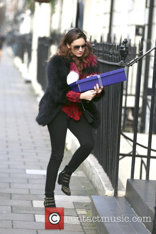 Kelly Brook returns to her London home