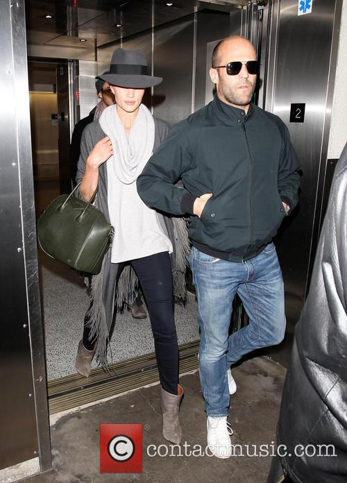 Rosie Huntington-Whiteley and Jason Statham arrive at LAX
