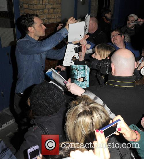 Jude Law signs autographs for waiting fans as...