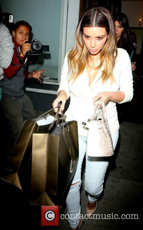 Kim Kardashian shops after meeting