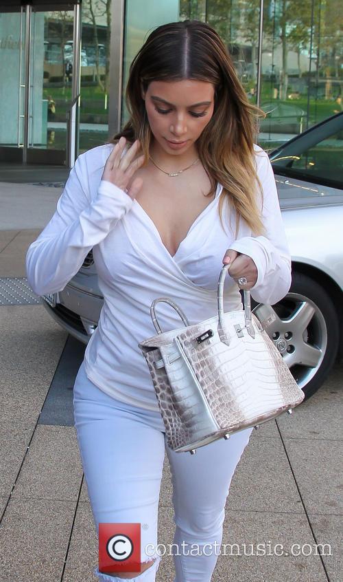 Kim Kardashian dressed in all white