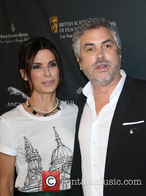 Sandra Bullock and Alfonso Cuaron 9