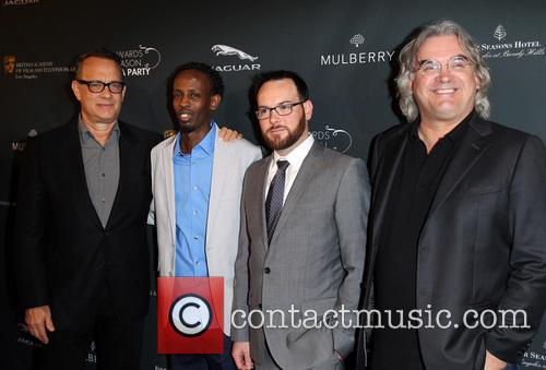 Tom Hanks, Barkhad Abdi, Dana Brunetti and Paul Greengrass 2