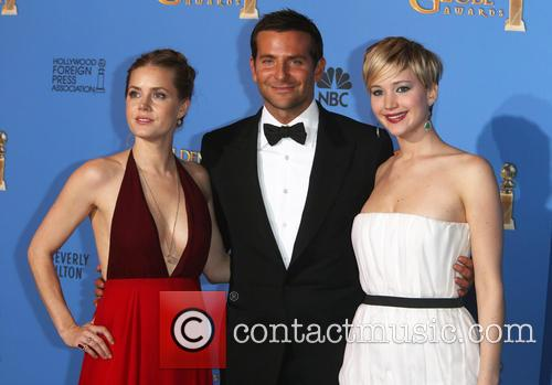 Amy Adams (r-l), Bradley Cooper and Jennifer Lawrence 1