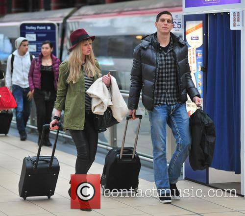 Liverpool football players leaving Liverpool Lime Street station