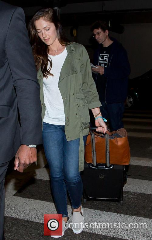 Minka Kelly arrives at Los Angeles International (LAX)...