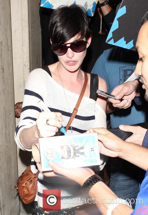 Anne Hathaway arrives at Los Angeles International (LAX)...
