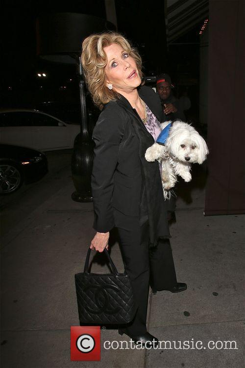 Jane Fonda and her dog outside Craig's