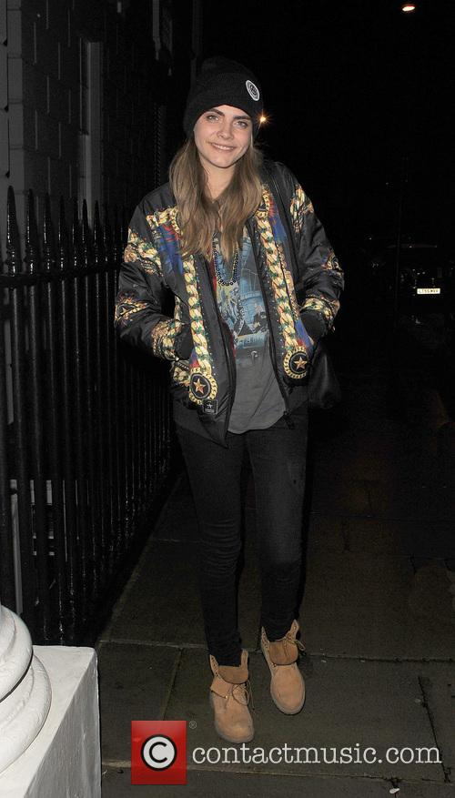 Cara Delevingne is all smiles as she returns...