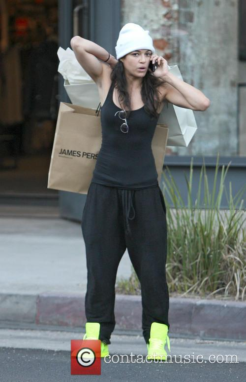 Michelle Rodriguez has her hands full