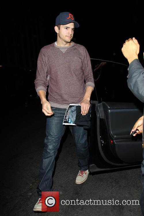 Ashton Kutcher returning to his car