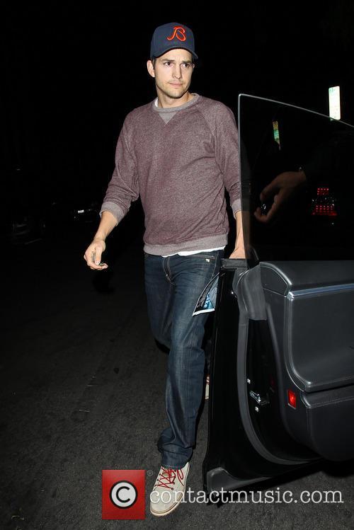 Ashton Kutcher returning to his car