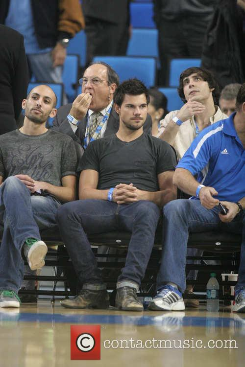 Taylor Lautner attends the UCLA game